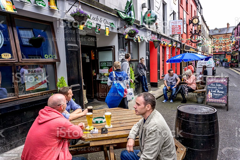 People sitting outside Irish pub in Wexford town centre stock photo