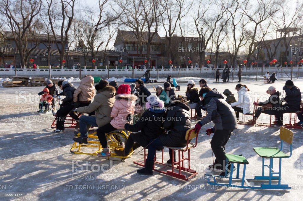 People skate on lake royalty-free stock photo