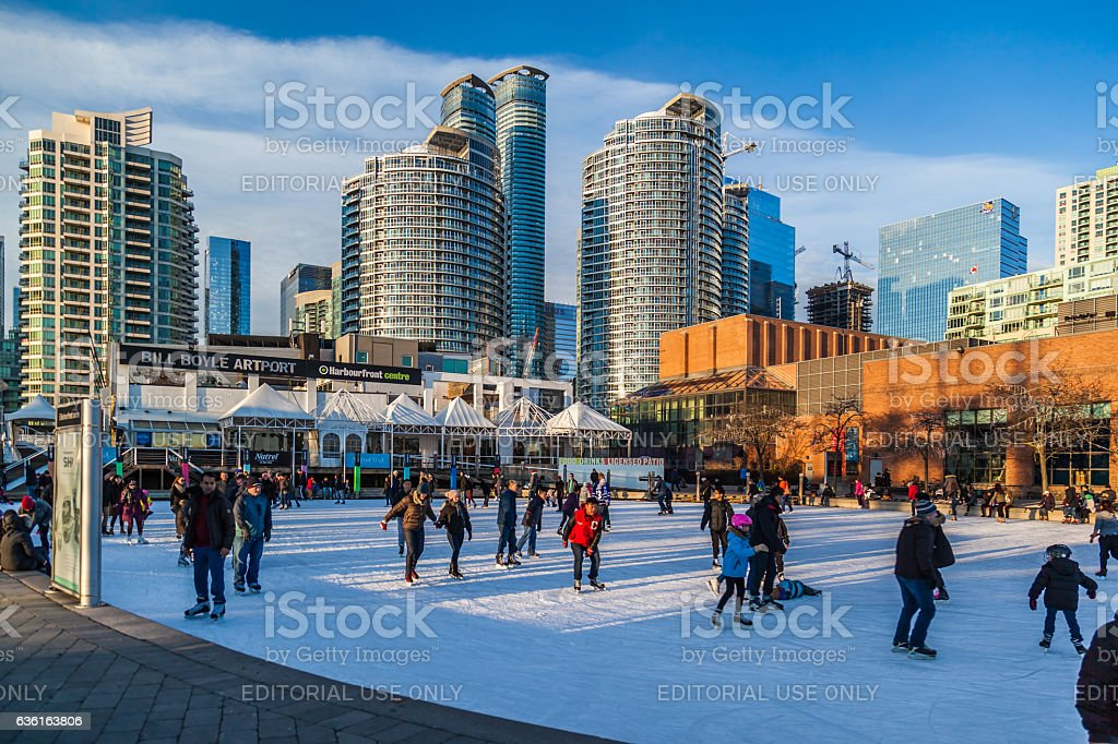 People skating at Harbourfront Centre public skating rink stock photo