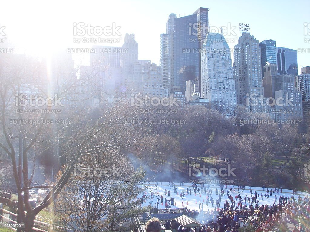 People Skating at Wollman Rink in Central Park in Manhattan. stock photo