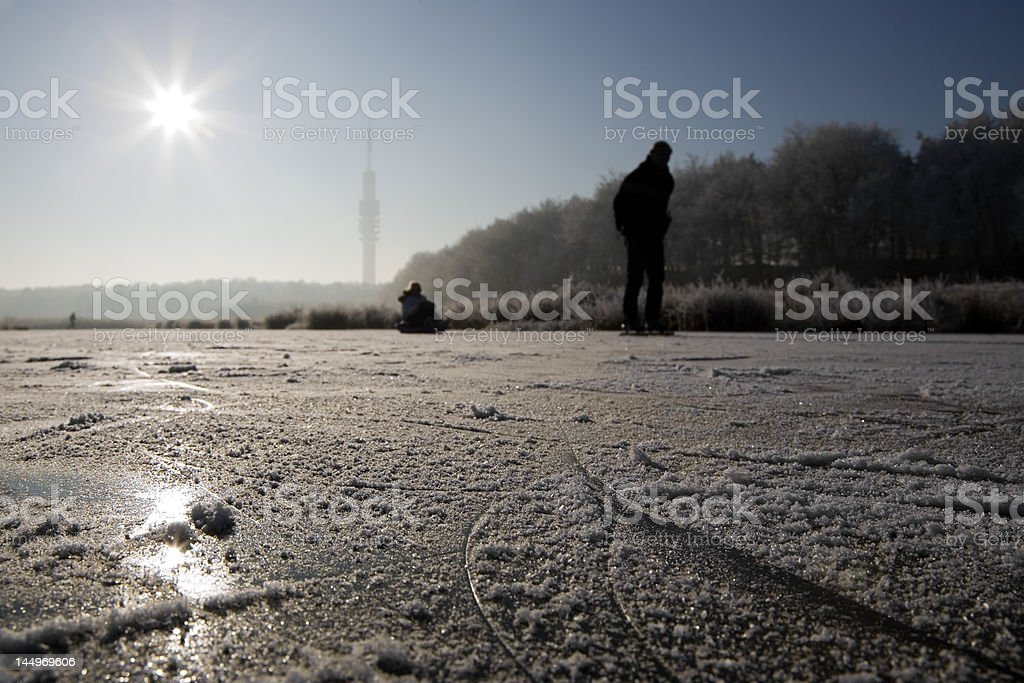 People skating on natural ice royalty-free stock photo