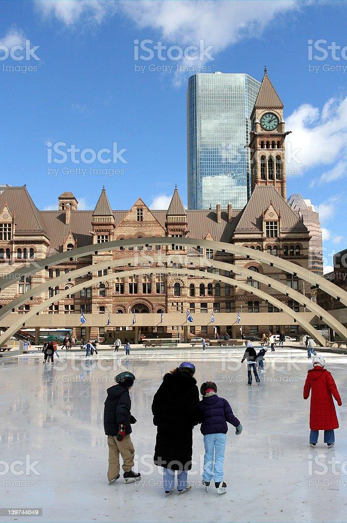 People skating on Toronto city hall skating rink stock photo