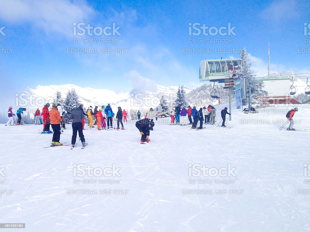 People skiing, Chairlift cable car and ski slopes in the stock photo