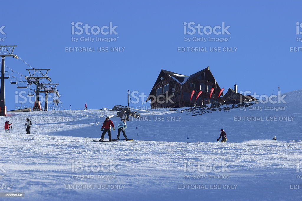 People skiing in front of Lynch Refuge 2- Andes Patagonia stock photo