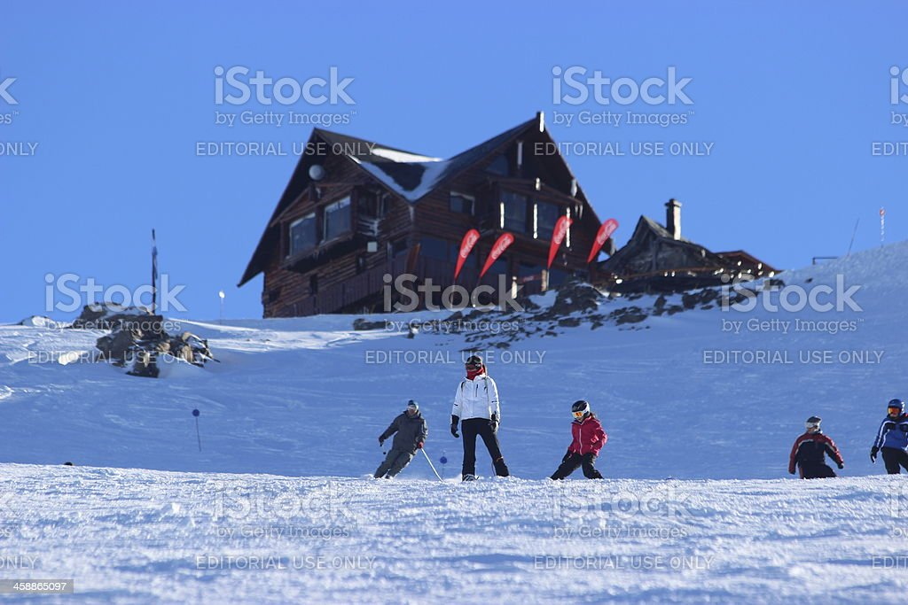 People skiing in front of Lynch Refuge 3- Andes Patagonia royalty-free stock photo