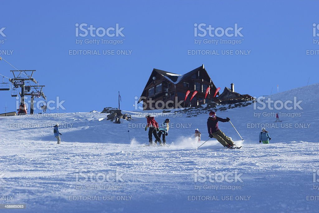 People skiing in front of Lynch Refuge - Andes Patagonia stock photo