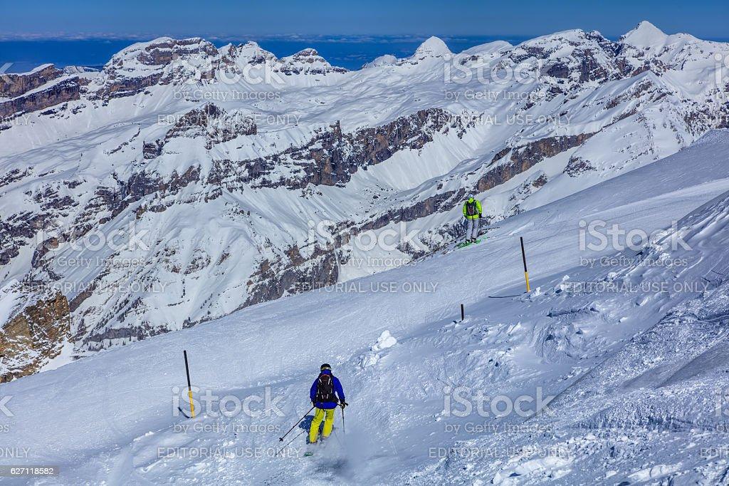 People skiing on Mt. Titlis in Switzerland stock photo