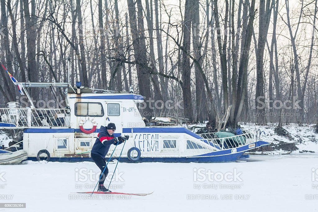 People skiing on the frozen river Tamis (a Danube tributary) stock photo