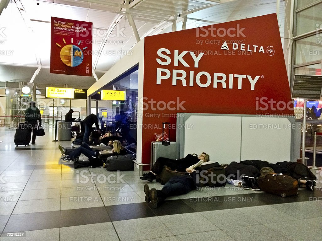 People sleeping on the floor at JFK Airport, New York royalty-free stock photo