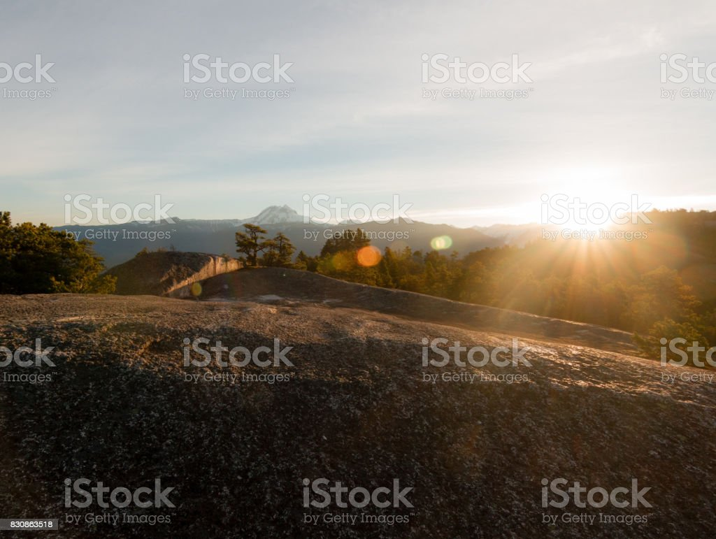 People sleeping on the top of mountains while sunrise stock photo