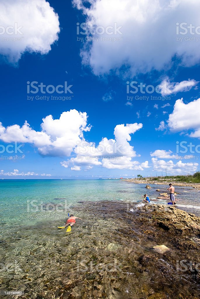 People snorkeling at the beach in Cozumel, Mexico stock photo