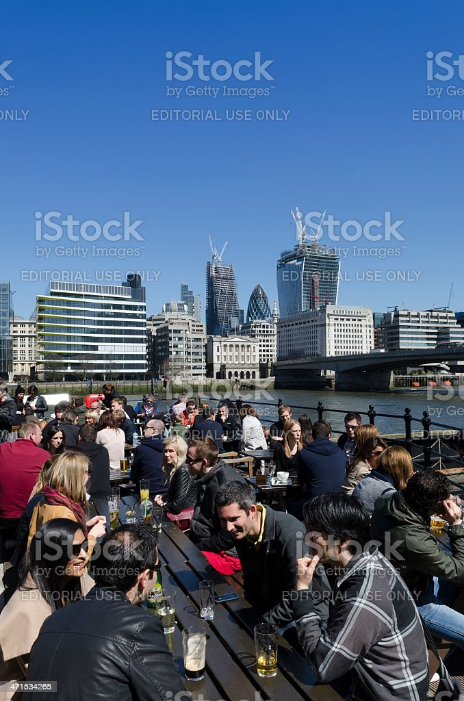 People socialising outside a pub, central London royalty-free stock photo