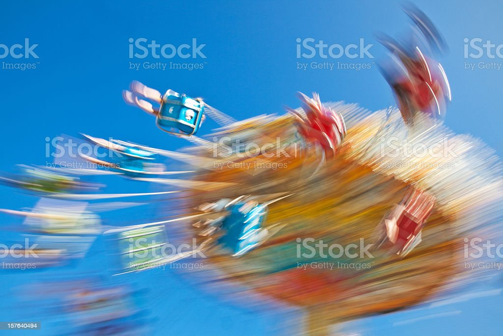 People Spinning on Carnival Swing Ride. Motion-Blur. stock photo