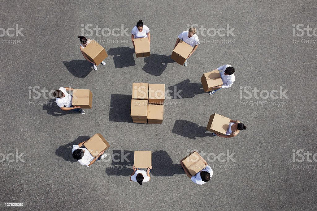 People stacking cardboard boxes royalty-free stock photo