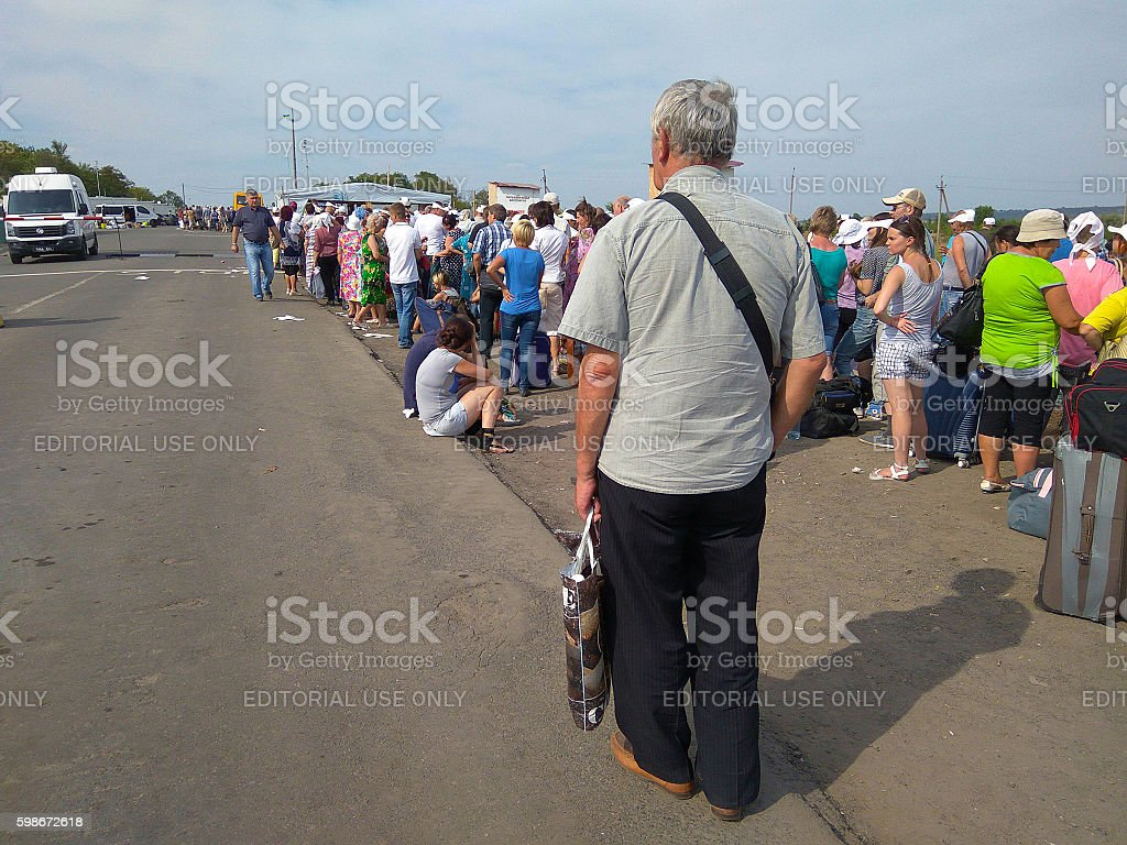 People stand in line at the intersection. Zaitseva, Ukraine stock photo