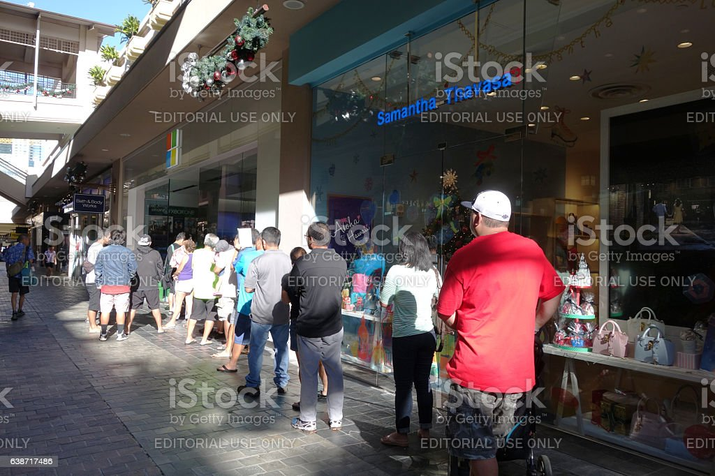 People stand in line to get inside Microsoft Windows stock photo
