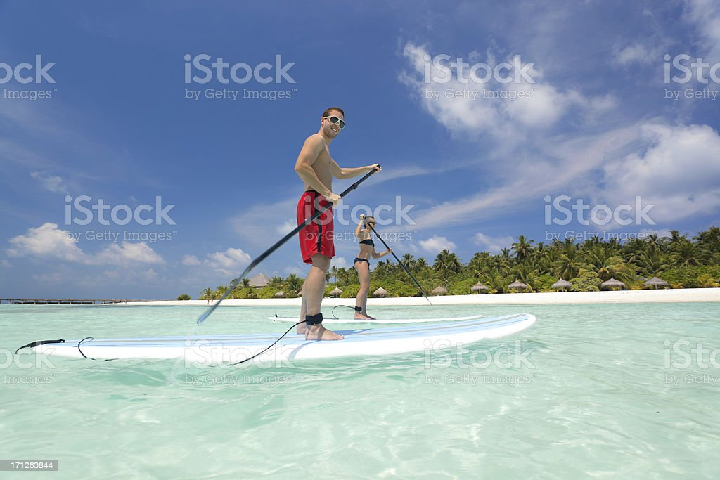 people stand up paddling lagoon royalty-free stock photo