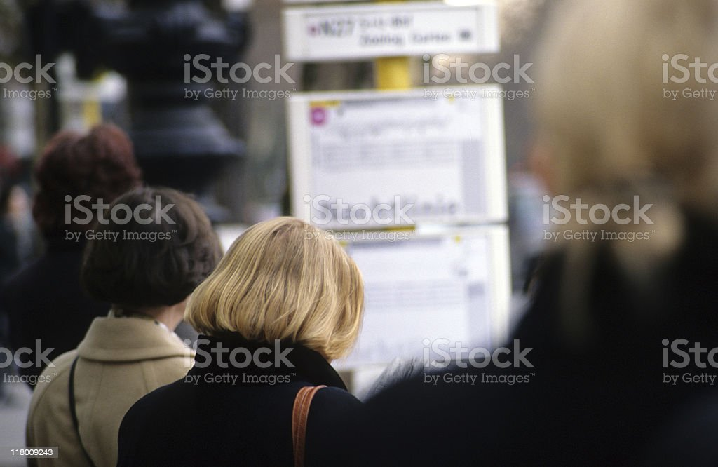 People standing at bus stop, rear view, Berlin, Germany royalty-free stock photo