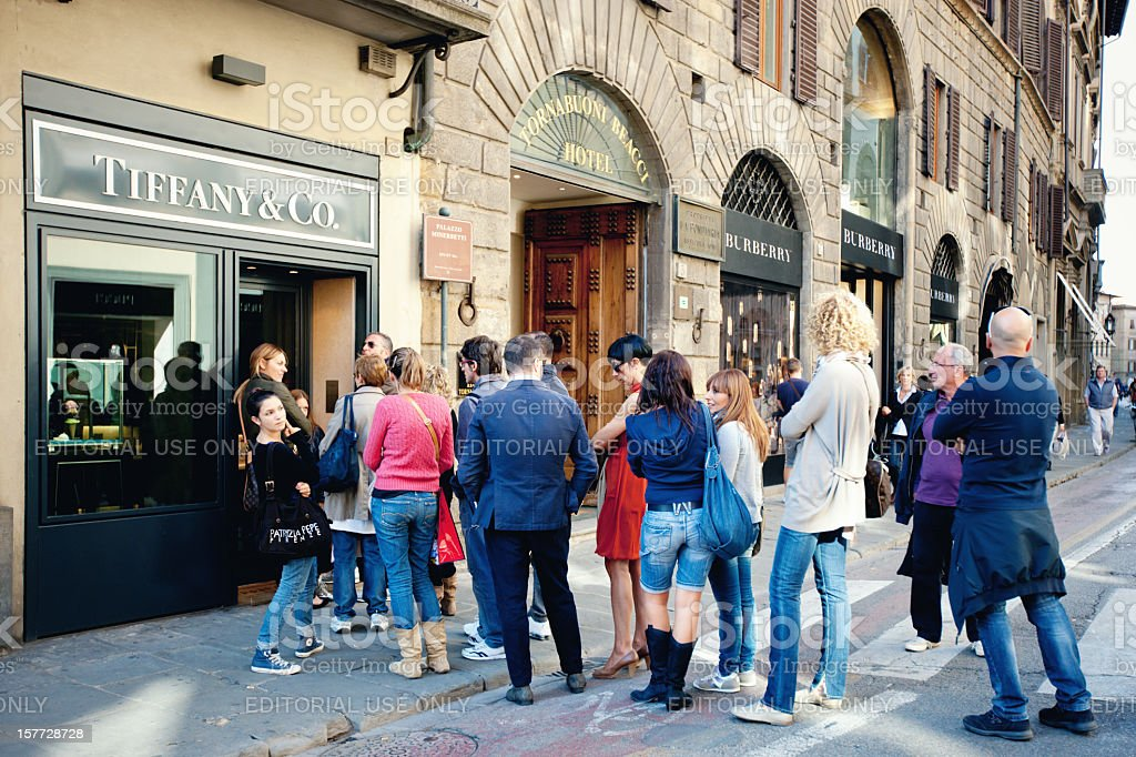 People standing in Queue, Tiffany & Co Shop, Florence, Italy stock photo