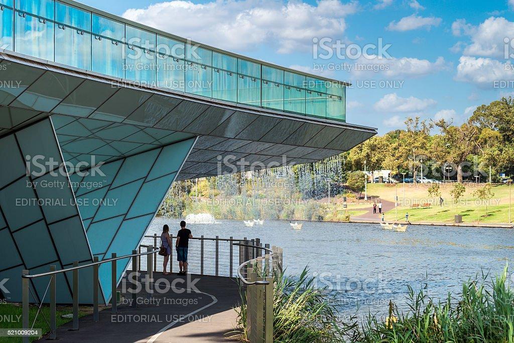 People standing under the foot bridge in Adelaide city stock photo