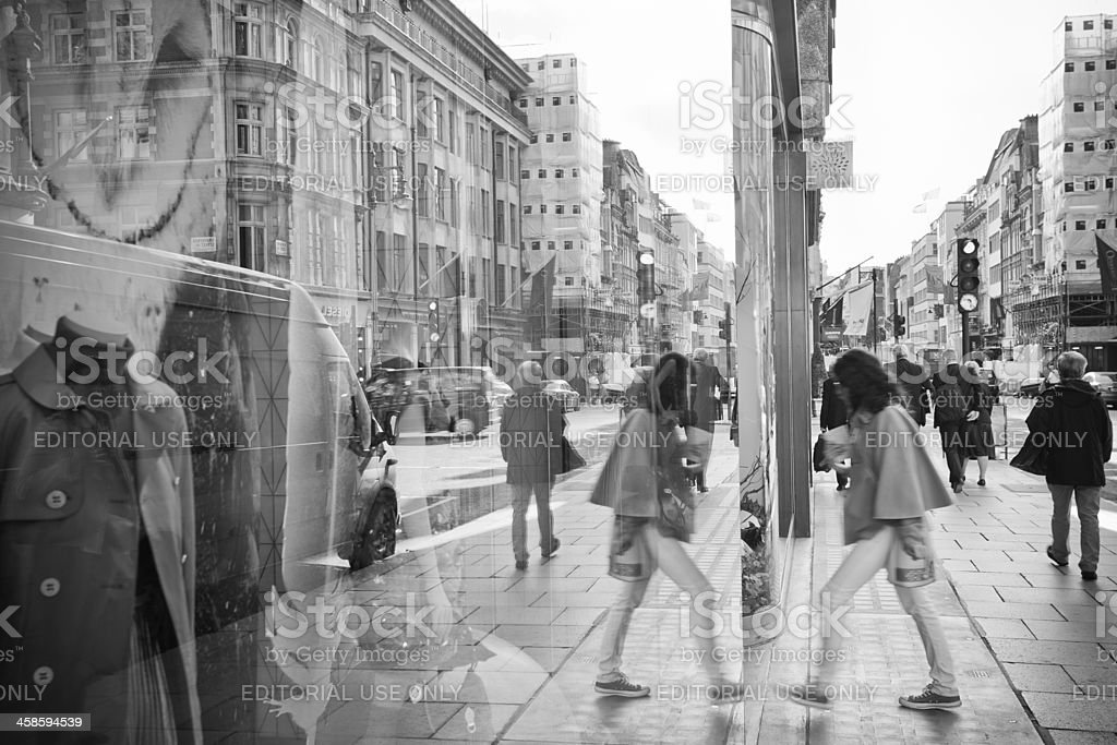 People Storefront Reflections on Bond Street Shop in London stock photo