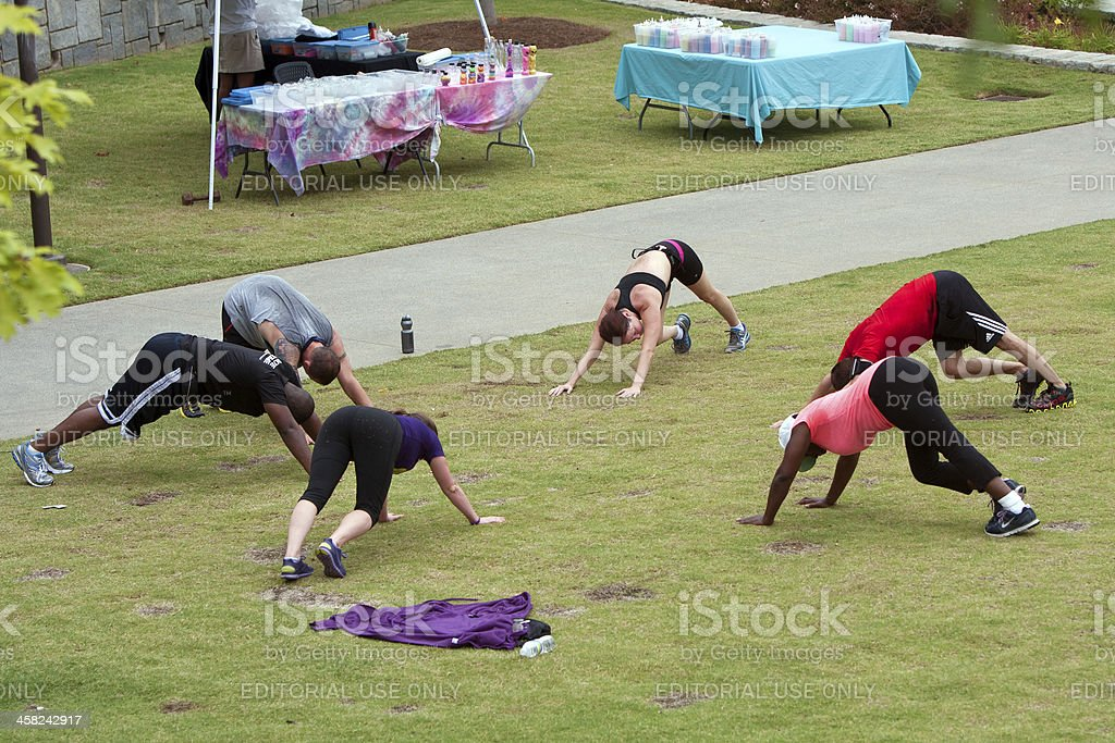 People Stretch Following Fitness Boot Camp Workout royalty-free stock photo