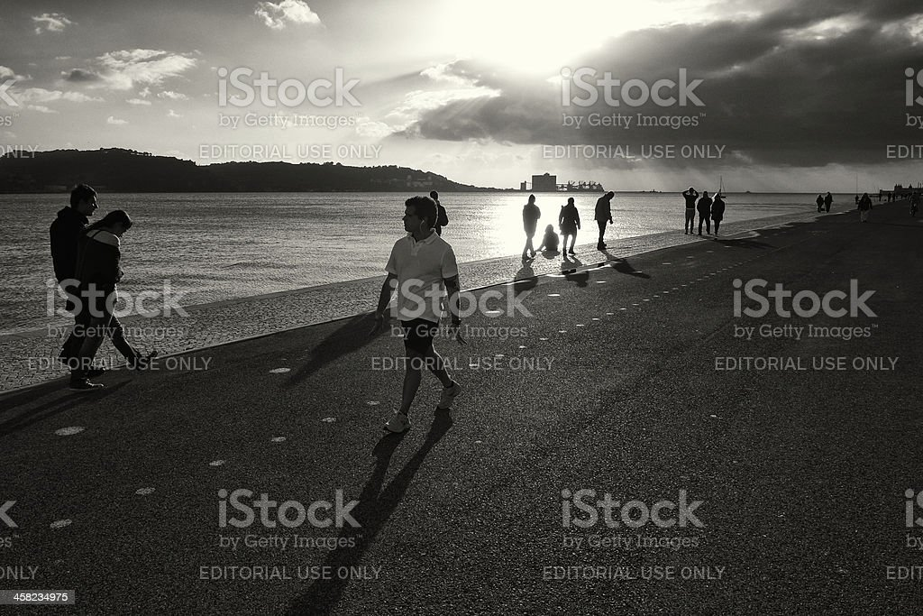 People Strolling by the Tagus River in Lisbon royalty-free stock photo