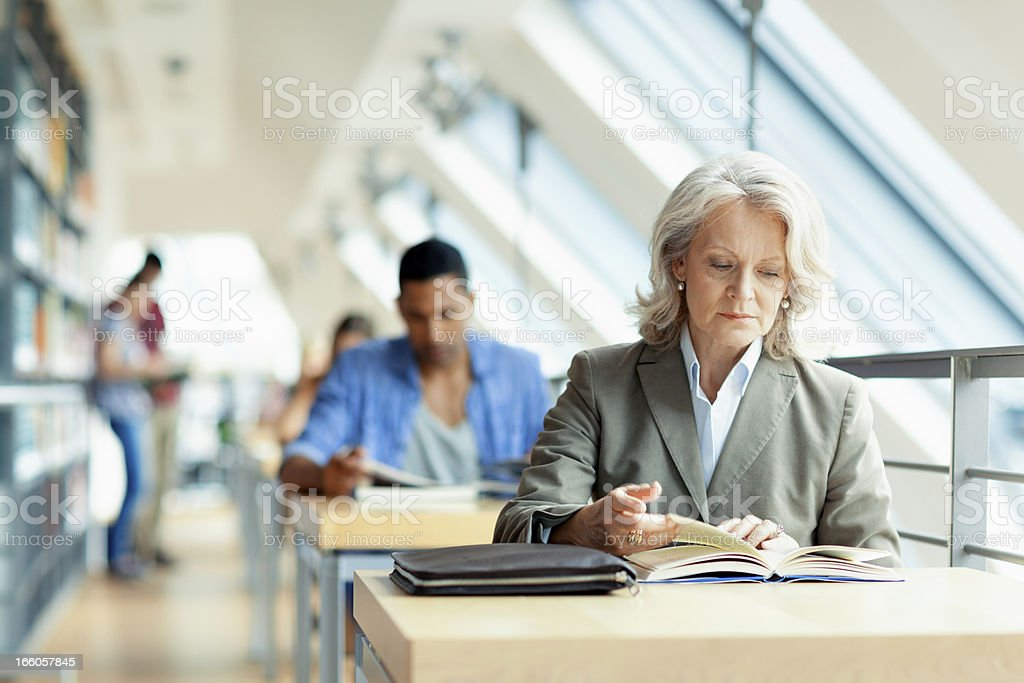 people studying in library stock photo
