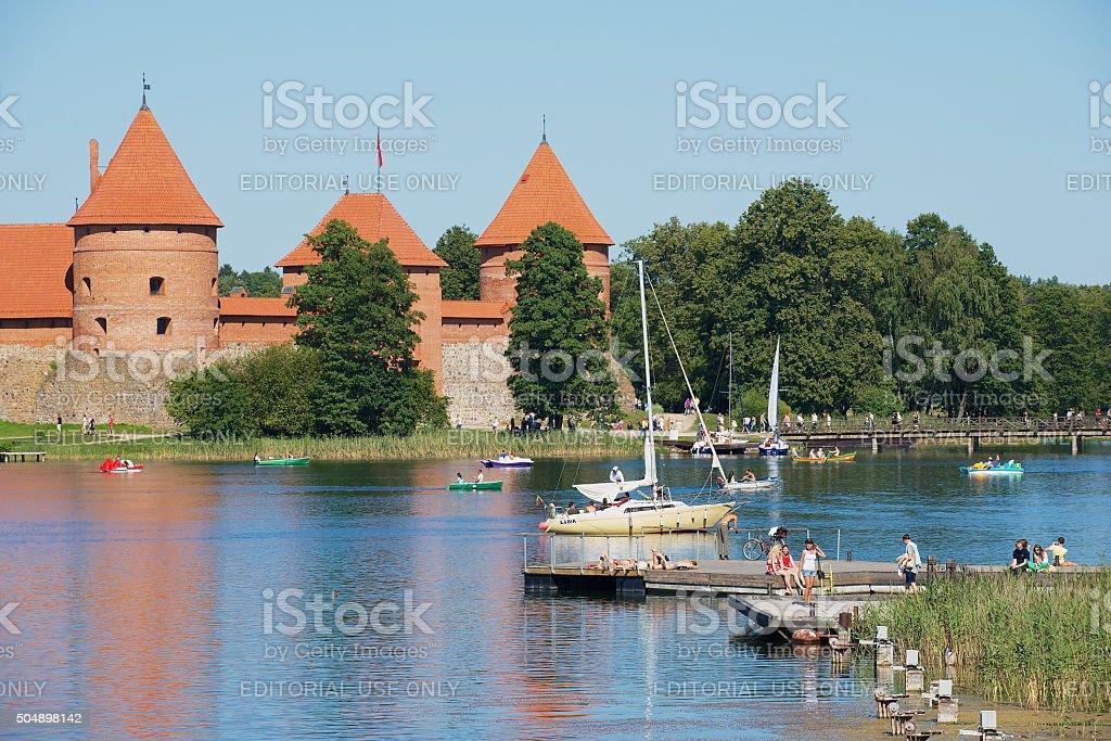 People sunbathe at Galve lake in Trakai, Lithuania. stock photo