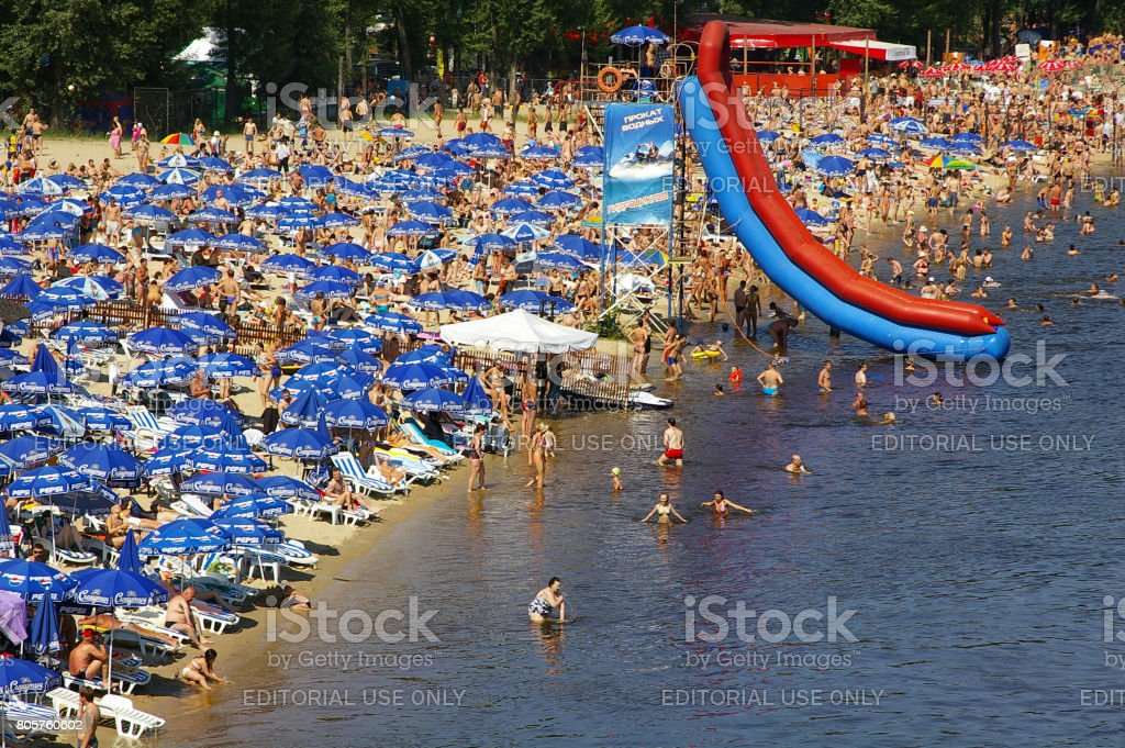 People sunbathing and having fun at the beach stock photo