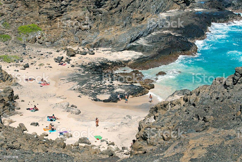 People sunbathing at Halona Cove in Oahu HI royalty-free stock photo