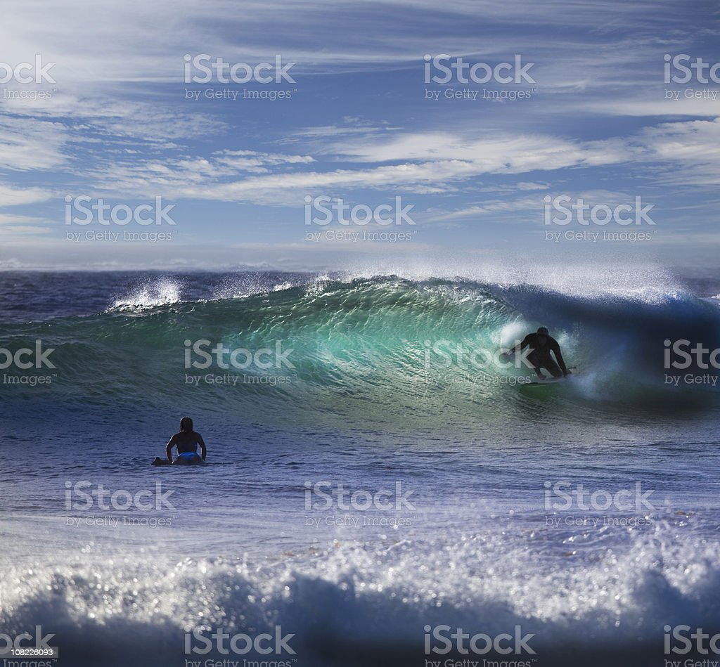 People Surfing at Beach in Waves royalty-free stock photo