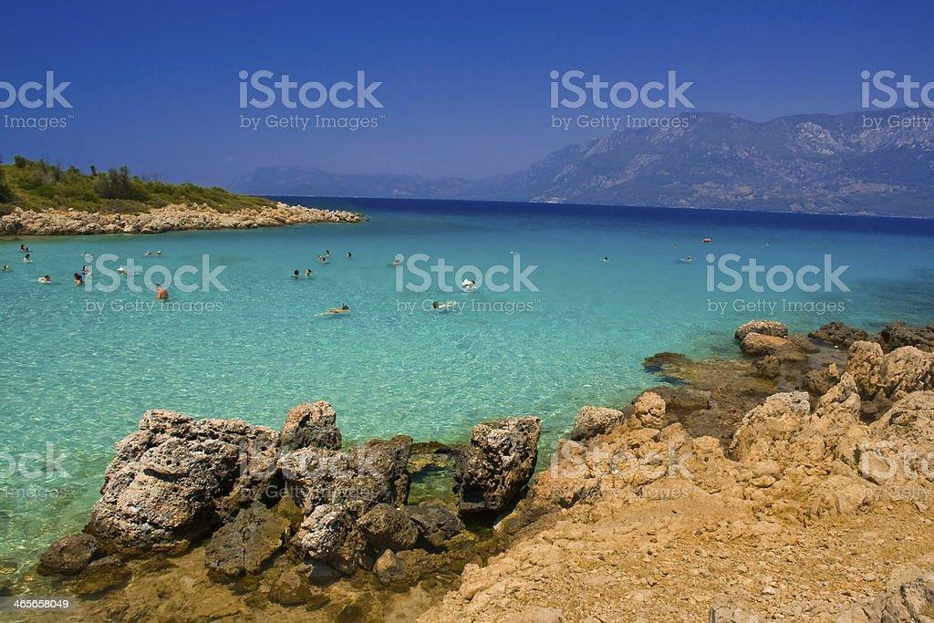 people swiming in turquoise sea stock photo