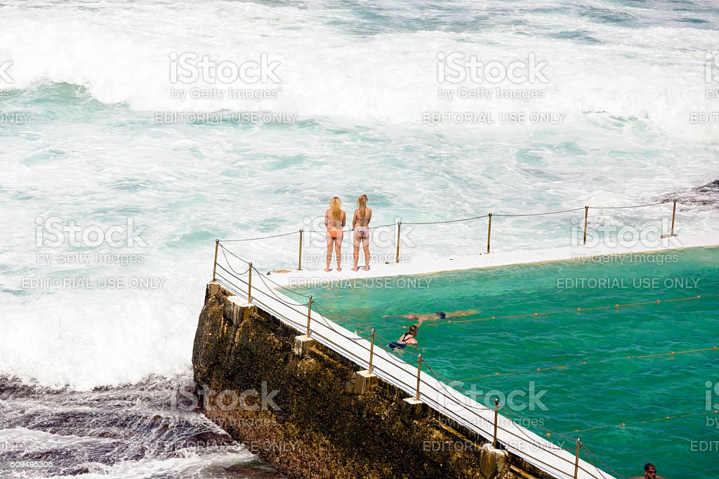 People swimming in ocean swiming pool, Bondi Australia, copy space stock photo