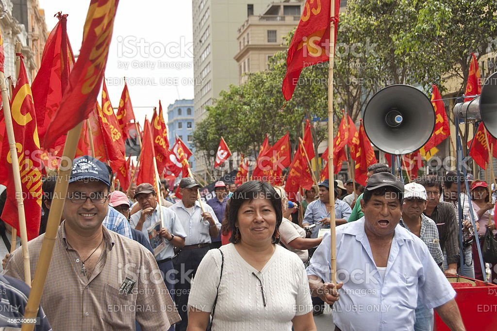 People take part at May Day demonstration in Lima, Peru. stock photo