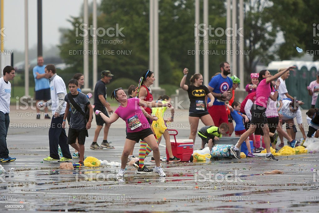 People Take Part In Huge Group Water Balloon Fight stock photo