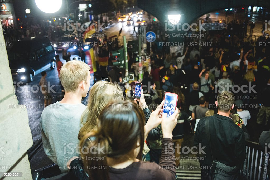 People take photos after Germany wins the World Cup royalty-free stock photo