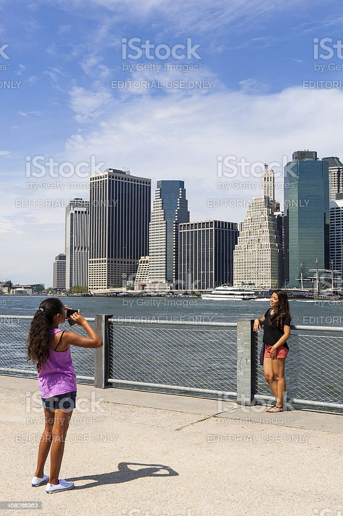 People take picture in front of Manhattan skyline, New York. royalty-free stock photo