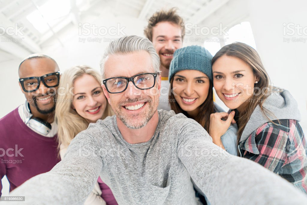 People taking a selfie at the office stock photo