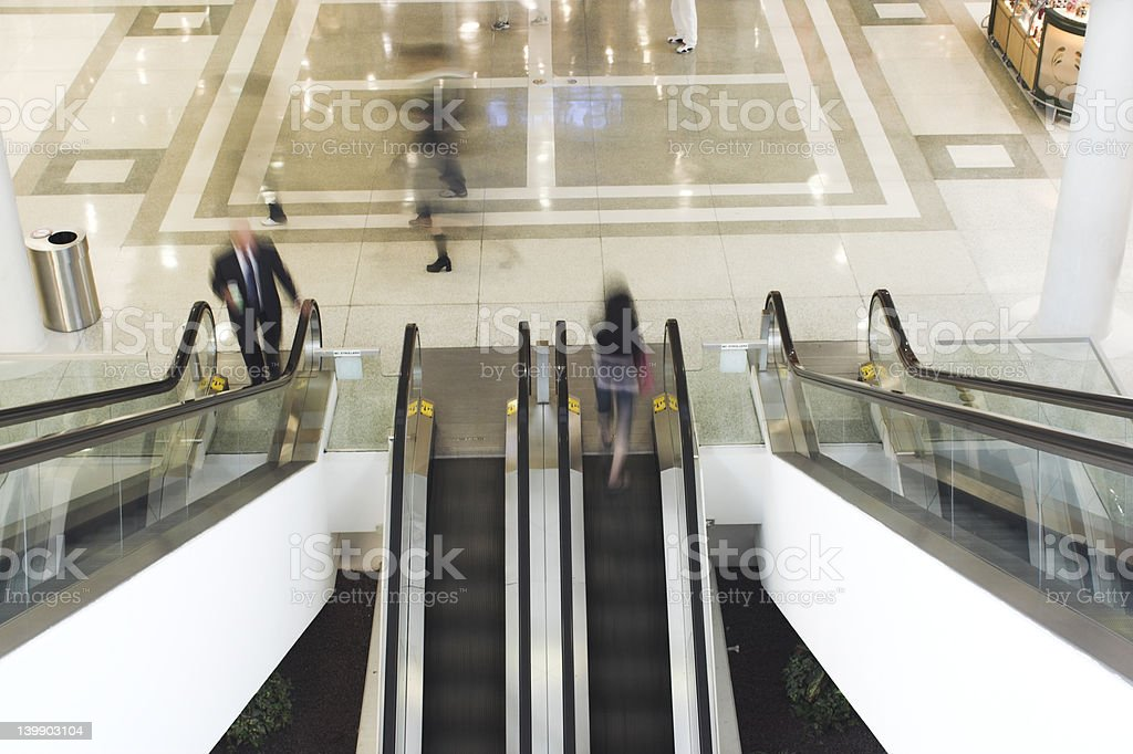 people taking escalator royalty-free stock photo