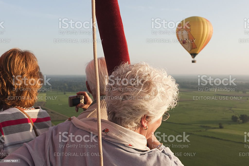 People taking pictures from hot air balloon stock photo