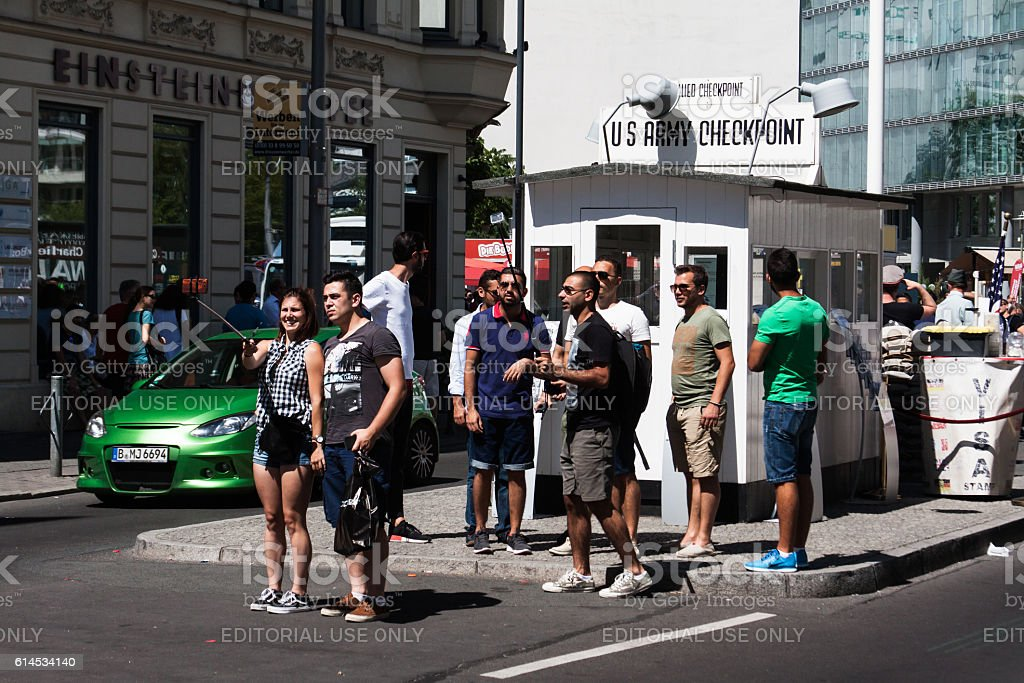 People taking selfies. Check Point Charlie, Berlin, Germany stock photo