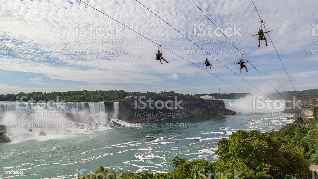 4 people taking zipline ride, Niagara Falls, Ontario. stock photo