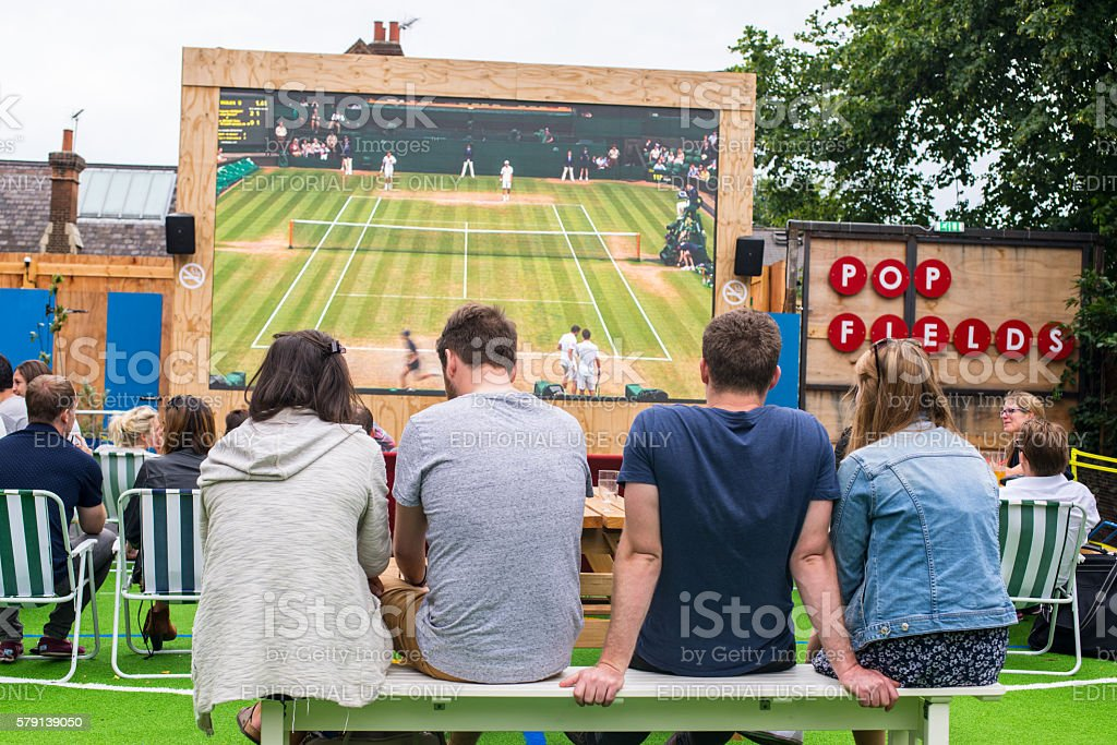 People talking and drinking in Pop Brixton, South London stock photo
