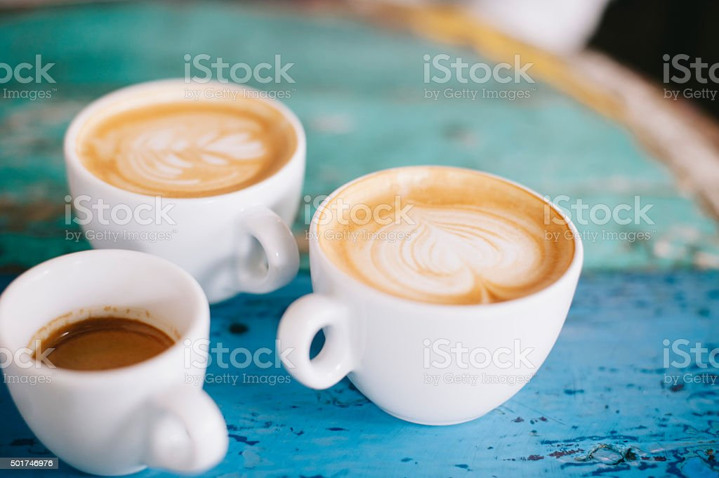 People talking in the cafe while having some fresh coffee stock photo