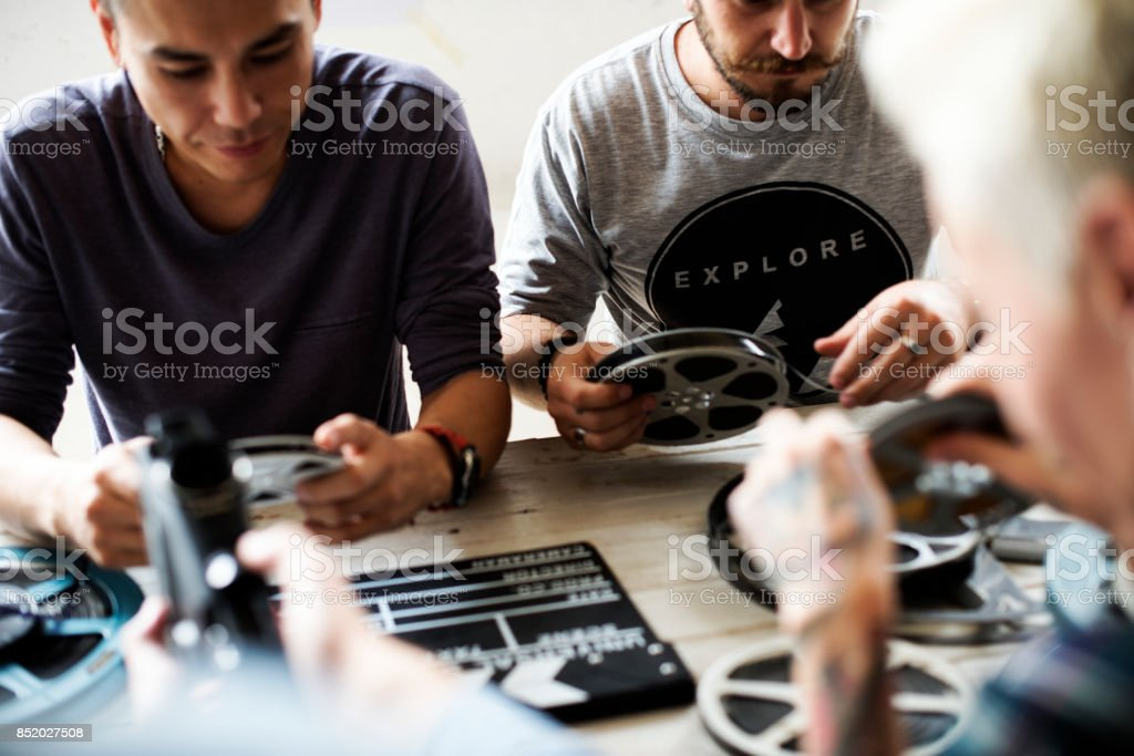 People talking sharing about vintage film strip stock photo