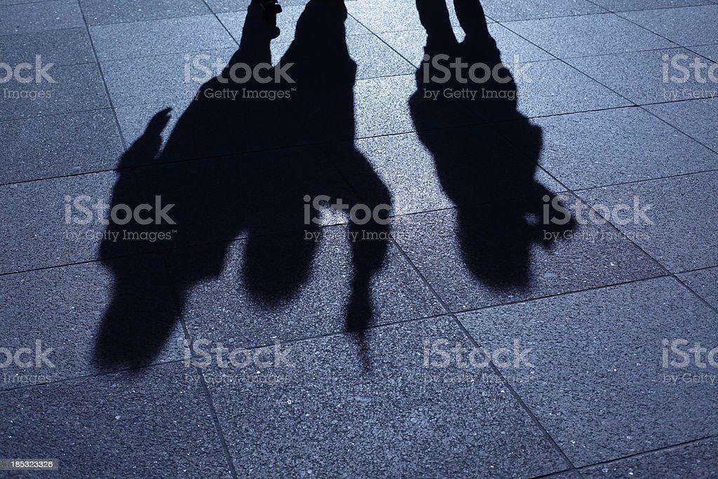 People threatening in blue night shadows stock photo