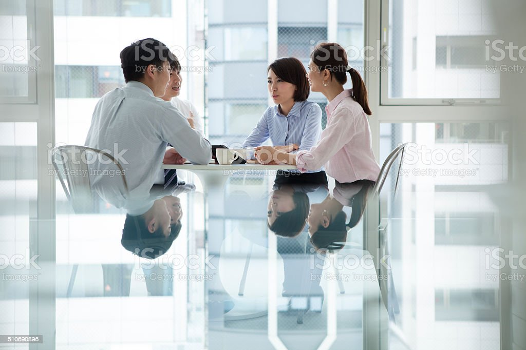 People to a meeting in the office stock photo