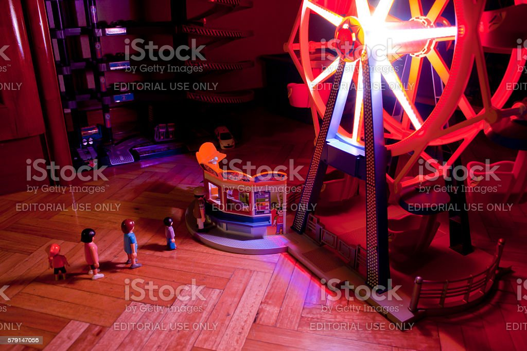 People to buy tickets for the Ferris wheel stock photo
