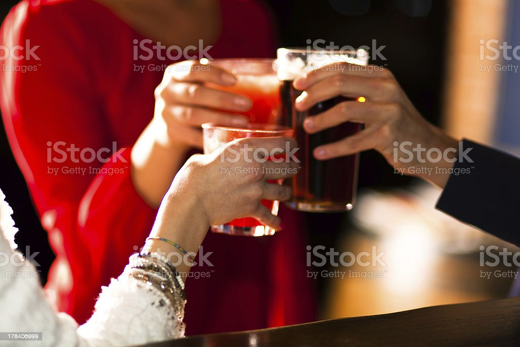 People toasting glasses of alcohol stock photo